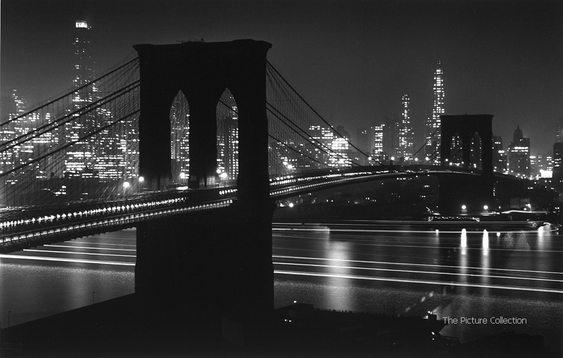Andreas Feininger (Brooklyn Bridge at night against background of lower Manhattan) US, New York 1948